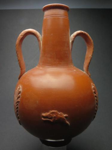 Roman Carthago sigilata bottle with boar and grain decoratio