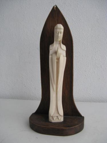 kleine madonna c op houten console