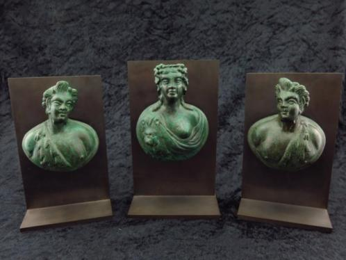 Set of three Roman bronze appliques of a noble women with tw