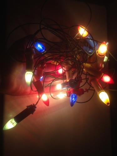 Oude antieke kerstlampjes kerstverlichting kaarsjes gekleurd