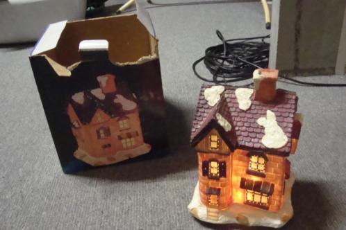 diverse kerst oa huisje met licht-kransen -kerstmannetjes
