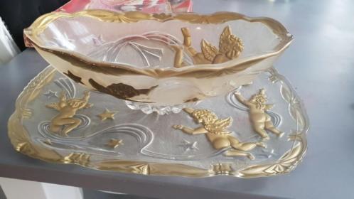 Schalen met gouden engeltjes