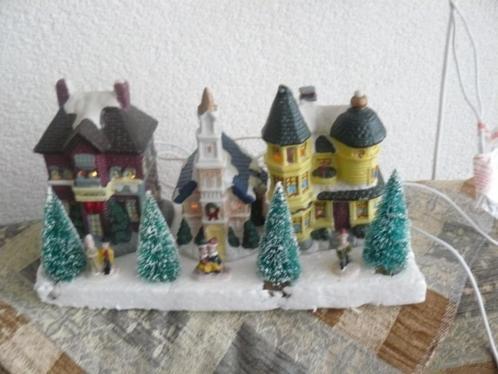 10 delig kerstdorp met verlichting.in orginele doos.