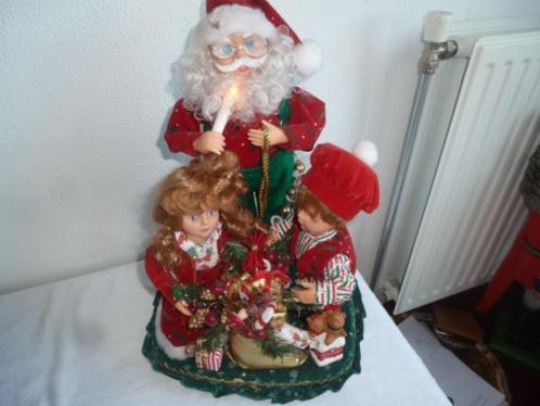 Muziekdoos Prachtige bewegende kerstman met kinderen