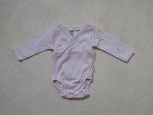(H96) Licht roze rompertje