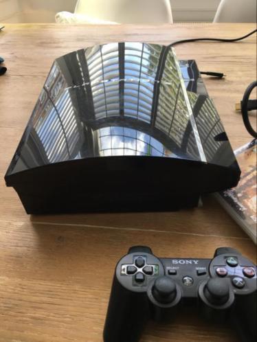 Playstation 3 in goede staat,kabels, controller, 2spellen