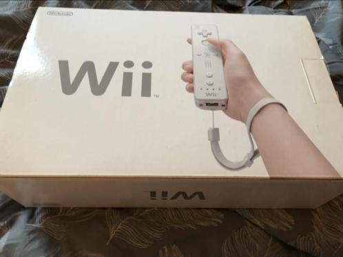Nintendo Wii, 4 games, 2 contollers, balanceboard, en meer
